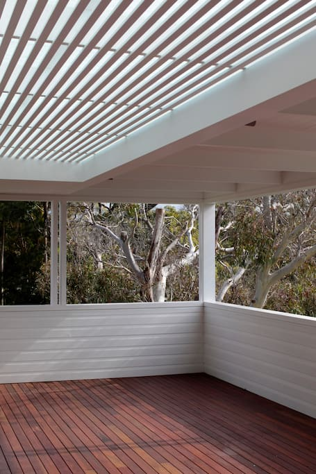 Large covered deck with district views.