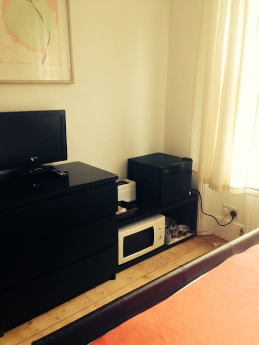 TV, microwave, fridge, toaster and kettle