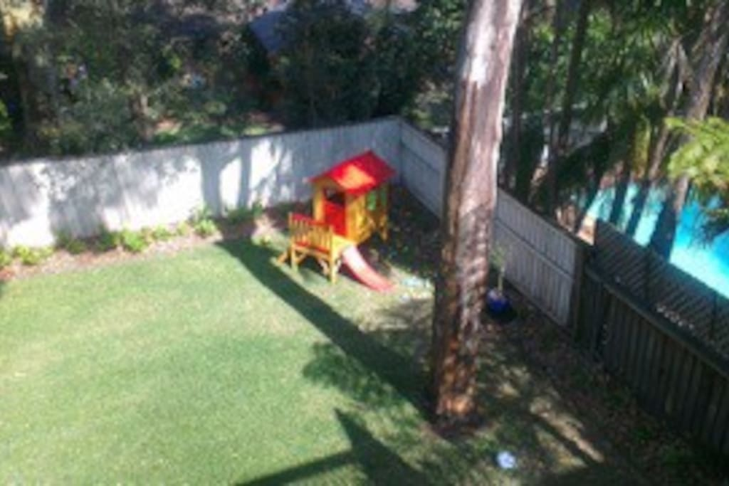 Fenced in safe and sunny back yard with cubby house and sand pit.