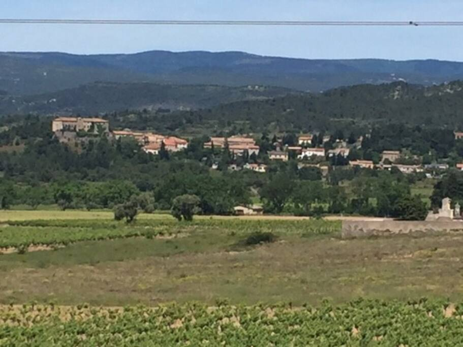 View from the village picnic area looking back at the villages of Oupia and Beaufort