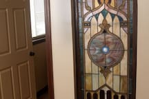 Beautiful stained glass window between the bedroom and bathroom.  Lit by a dimmer switch, what a wonderful night light.