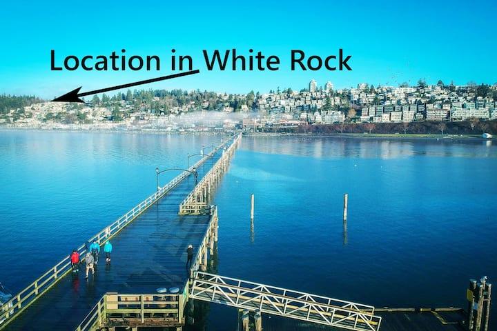 """White Rock. Perfect location. """"The Red Umbrella."""""""