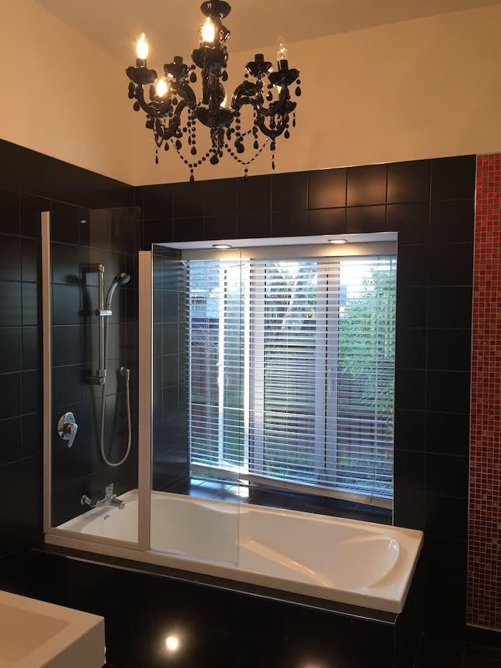 Main bathroom, Shower and a bath, total privacy if you want to leave windows or blinds open when you shower or bath as nobody can walk past as it is fenced off outside for your privacy