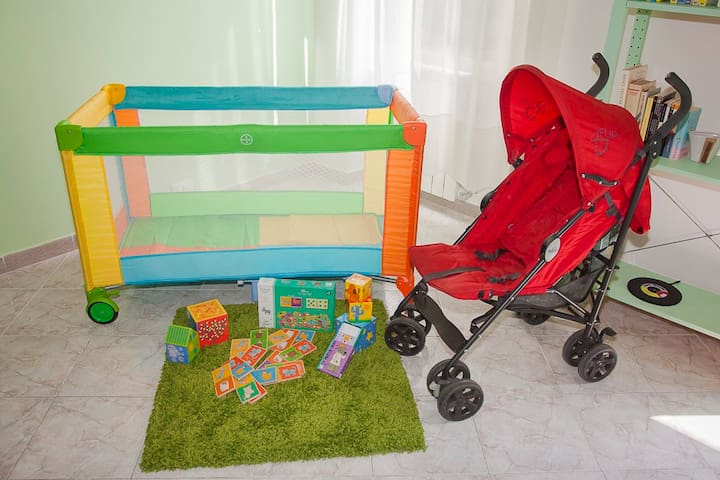 For families, upon request: cot, changing table, stroller, toys and books for your children