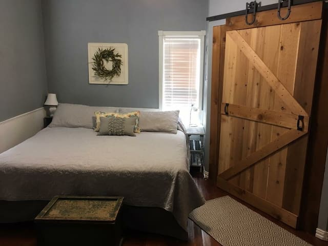 Master bedroom with king size bed. Barn doors complete the cozy country feel!
