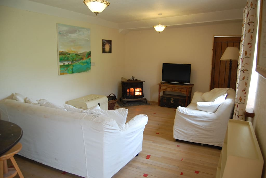 Comfortable sitting area with high output wood burner. Wood included