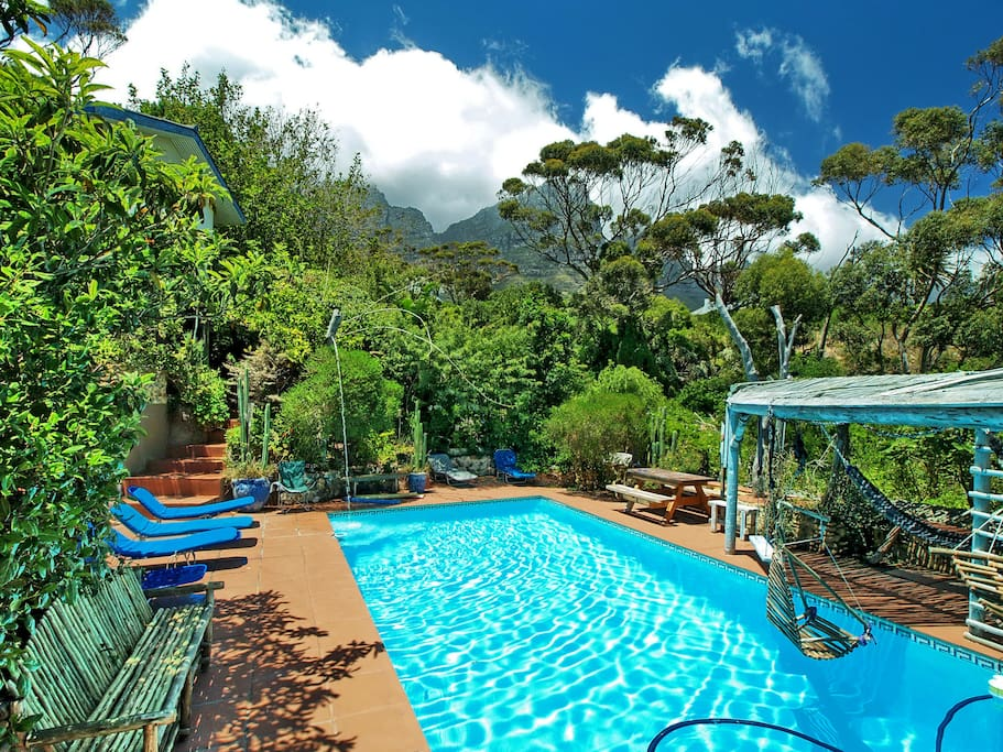 Hammocks at the pool and the nature reserve and river with mountains in background. Can easily walk to beach