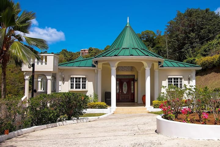 Entrance to the stunning 5 bedroom, 6 bathroom Villa. Tucked away on a beautiful Cove overlooking the Caribbean Sea.