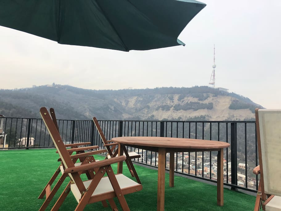 BBQ place with city and mountain view