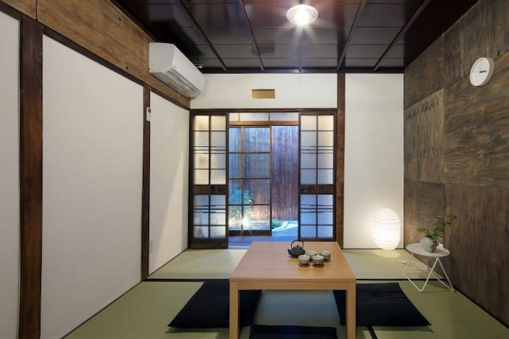 """On the first floor, there is a Japanese style living room called """"IMA"""". In the """"IMA"""", you can lay a FUTON  for two people by clearing the desk."""