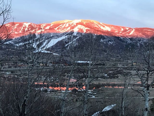 Alpenglow sunset!  Check out the reflection on the Yampa River below. This is the view from your private deck, Enjoy!