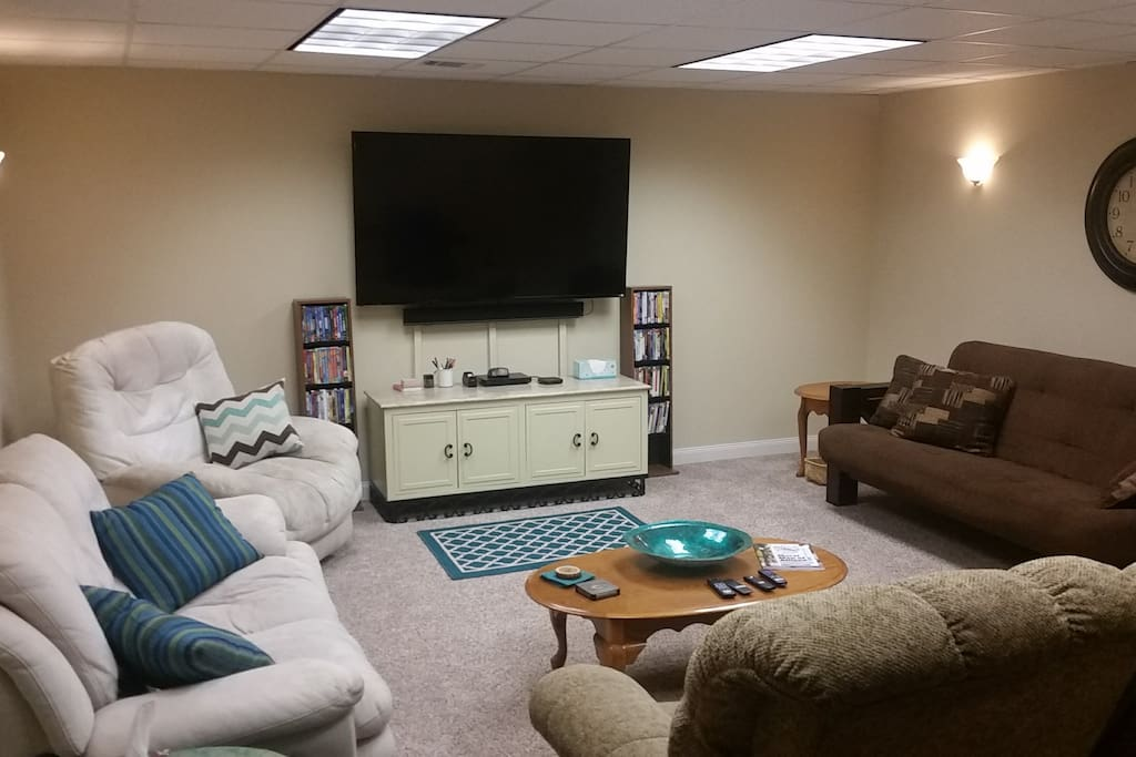 "Large living room area with 70"" TV featuring surround sound system, family friendly DVD's Netflix (no cable)."