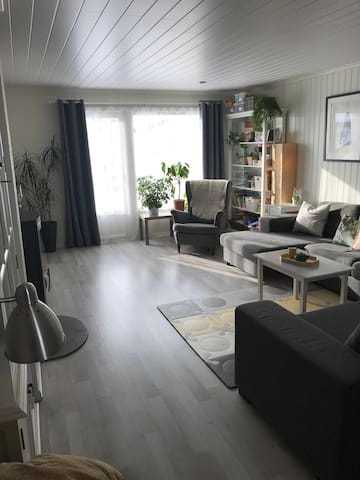 Living room with a smart TV and plenty of sitting space