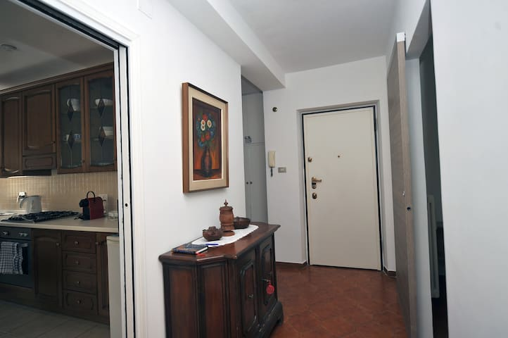 View of the hallway that connects all the rooms in the apartment. The front door is armored.