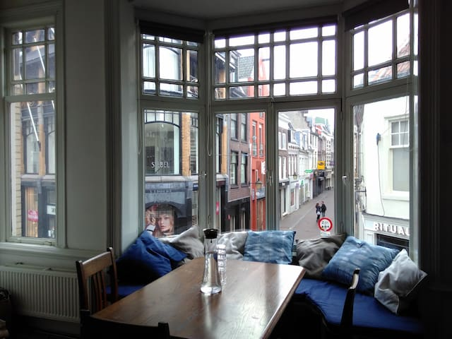 Bay window with table and view on the shopping street