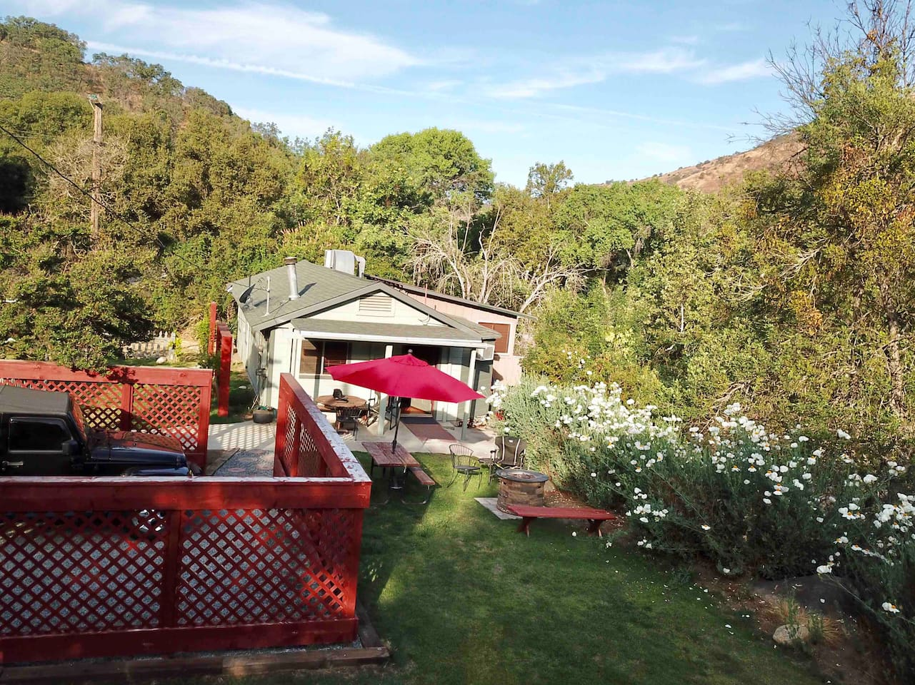 The Kaweah Cabin is just off the Sierra Highway. (2 lane road) just 1 & 1/2 miles from the Park Entrance Gate.  The river below can be heard rushing by.  BBQ, fire pit, surrounded by greenery. Family friendly fun.