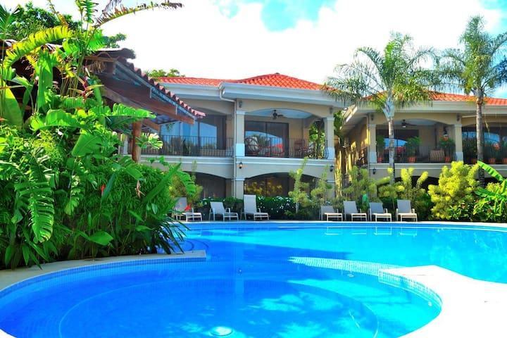 Pool front Condo with large terrace ground floor
