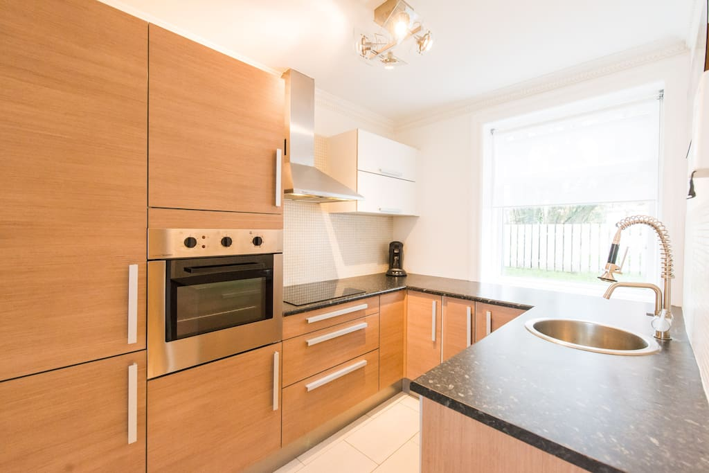 Fully equipped kitchen with Oven, Microwave and Dishwasher.