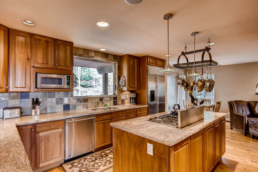 Granite counters and stainless appliances (including dishwasher) in the full kitchen
