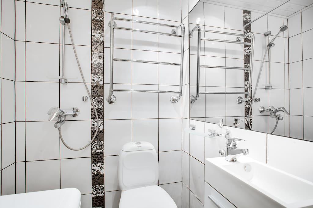 Stylish bathroom with shower.