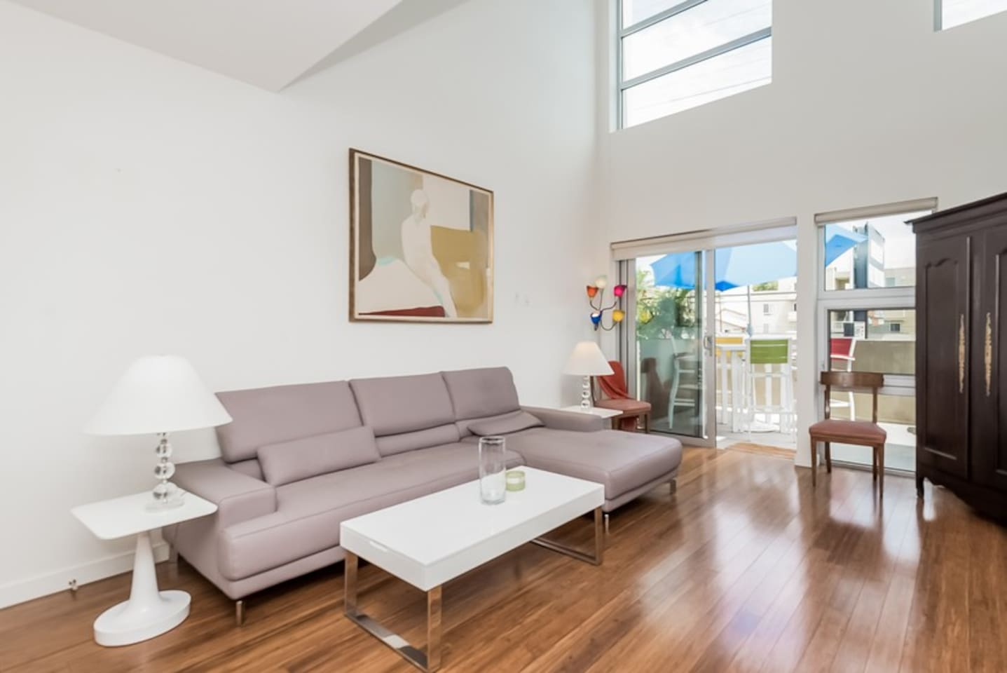 Clean open loft space with high ceilings and private outdoor patio.