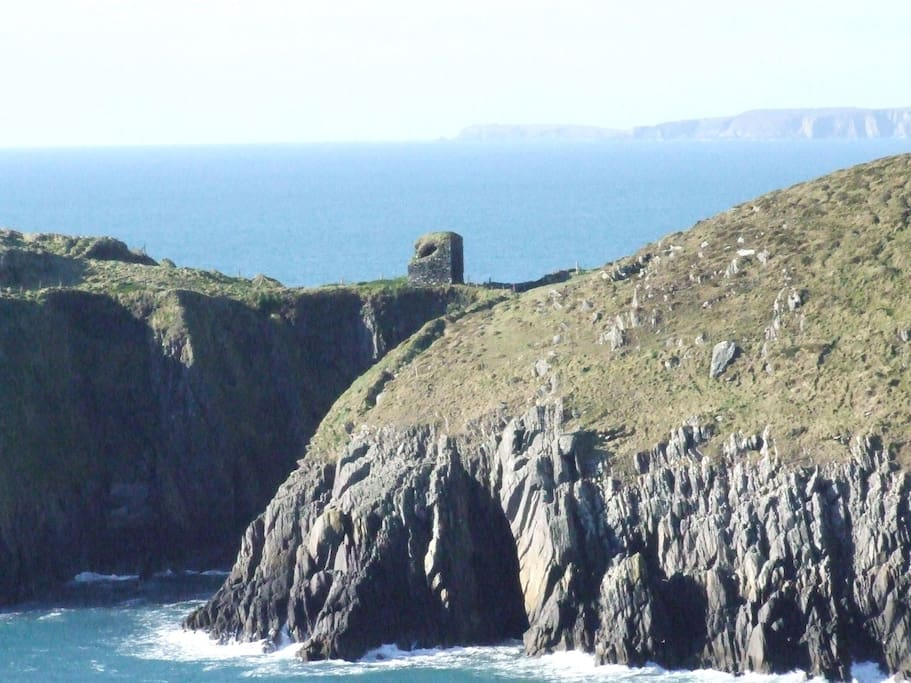 Guard tower teeters on the headland flanked either side by the rough Atlantic. 15 minute walk from coach house