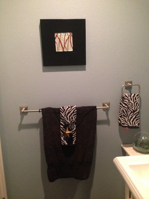 Luxurious towels & linens in both bathrooms await you  in 1/2 bath mere steps from your private bathroom