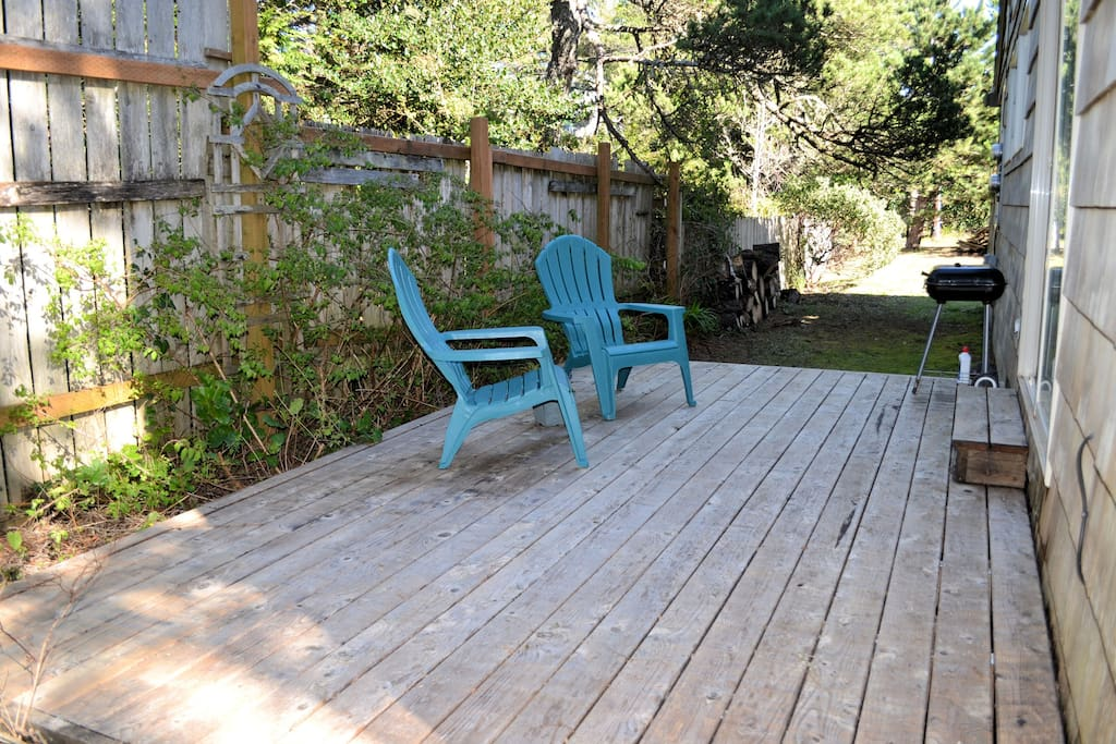 Outside deck with BBQ and 2 chairs