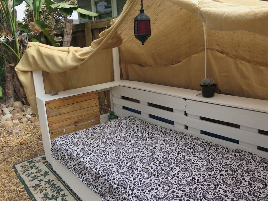 Our handmade gypsy outdoor couch. It's perfect to relax reading, drinking a glass of wine, or just watching the stars.