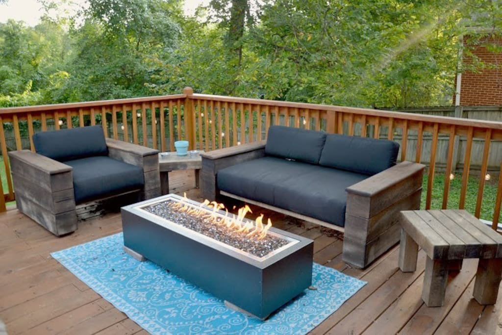Our deck includes outdoor seating from Restoration Hardware, a custom live edge dining table, glass top fire pit, BBQ and colorful seating.