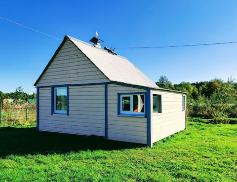 House 6x6m. 200 km from St.Petersburg. Daily/long term. Lake Ladoga, schears, cliffs, clean air. Shower (hot water supply/cold water supply). Kitchen (stove with breath, electric), microwave, furniture, two 2 beds, TV, refrigerator, barbecue, gazebo. Boat on the oars-additional service