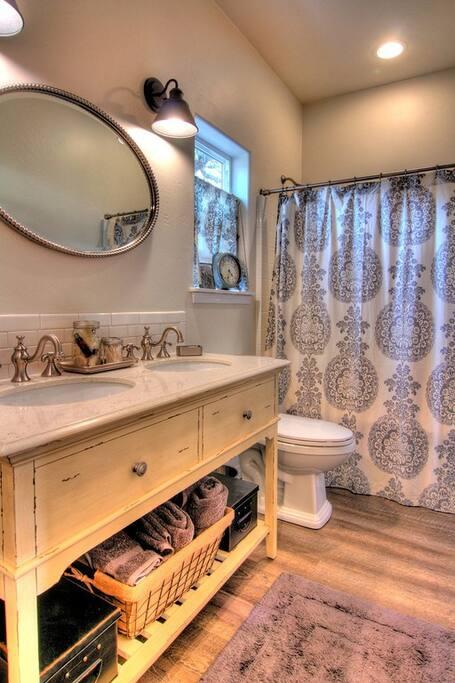 Luxurious dual sink bathroom with tub