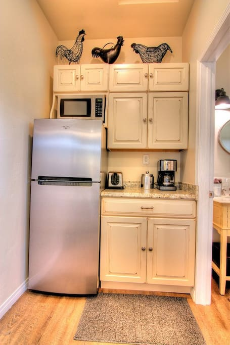 Kitchenette complete with refrigerator, microwave, toaster and coffee maker