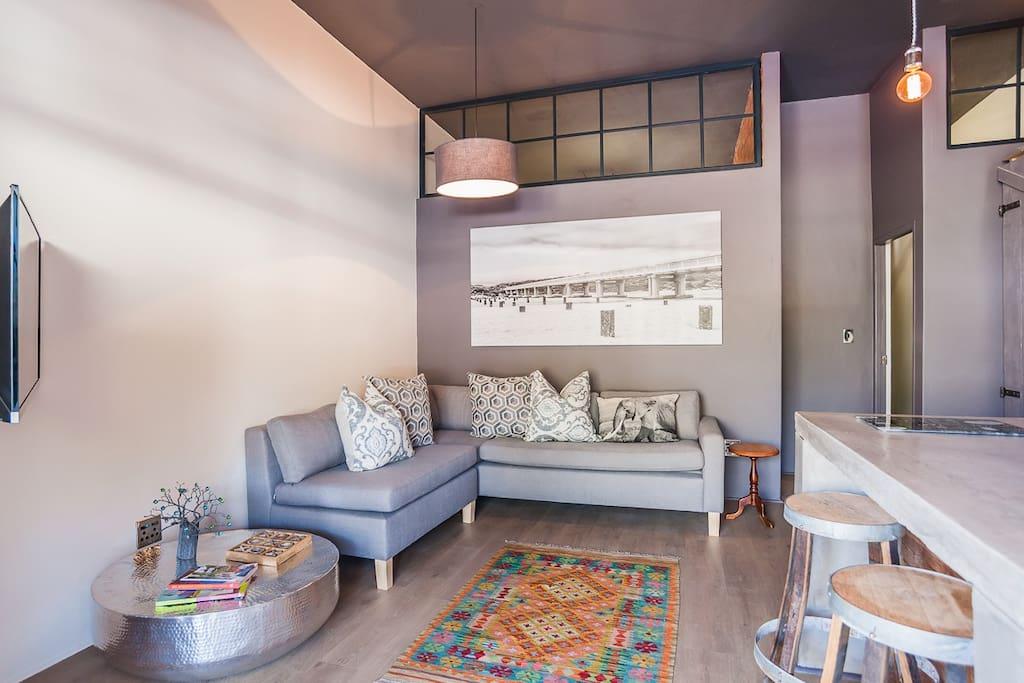 Open plan lounge/kitchen/dstv