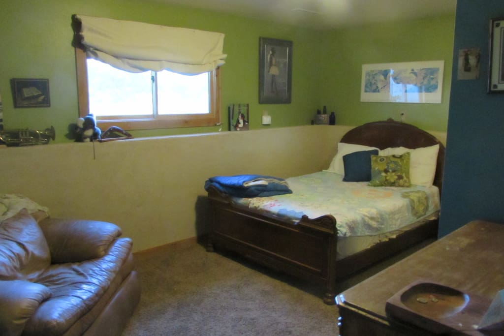 Sizable bedroom with gorgeous antique bed with double mattress
