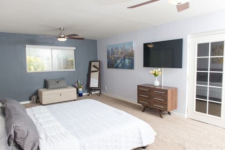 Master Bedroom - Equipped with a 55' inch LED Smart TV with live streaming SLING television, a king size Tuft & Needle mattress and dual remote controls to allow each guest to control their own light and fan speed. There is also a pullout sofa bed.