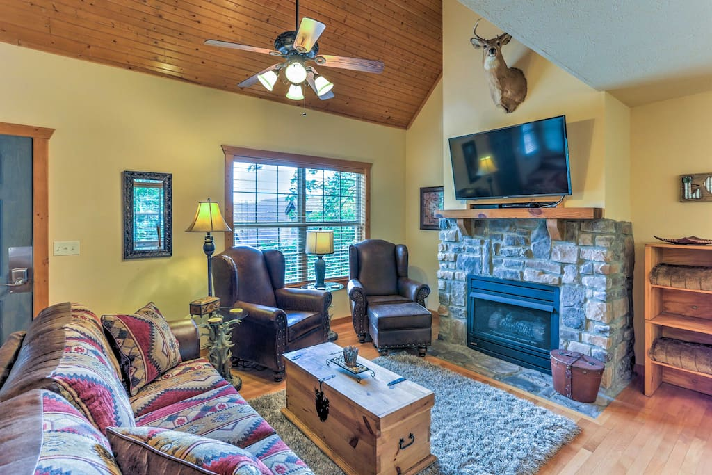 Inside, the rustic cabin features a country ambiance with wood floors, a lot of wood accents and comfortable, quality furniture.