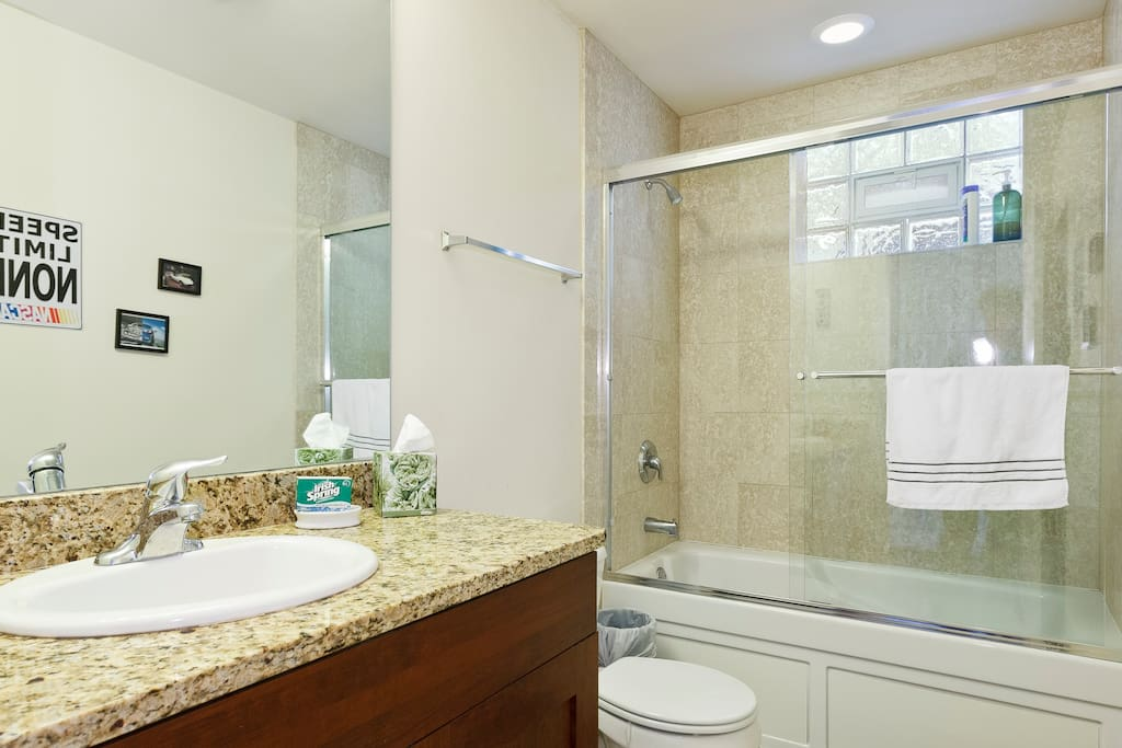 Private bathroom for guests in the master suite.  High Quality towels and washcloths provided.  Shower head has been upgraded since this picture.