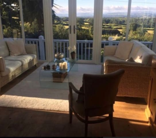 Guest sun/TV room with glorious views across the Vale of Clwyd. There also books and board games available for guests to use during their stay with us.