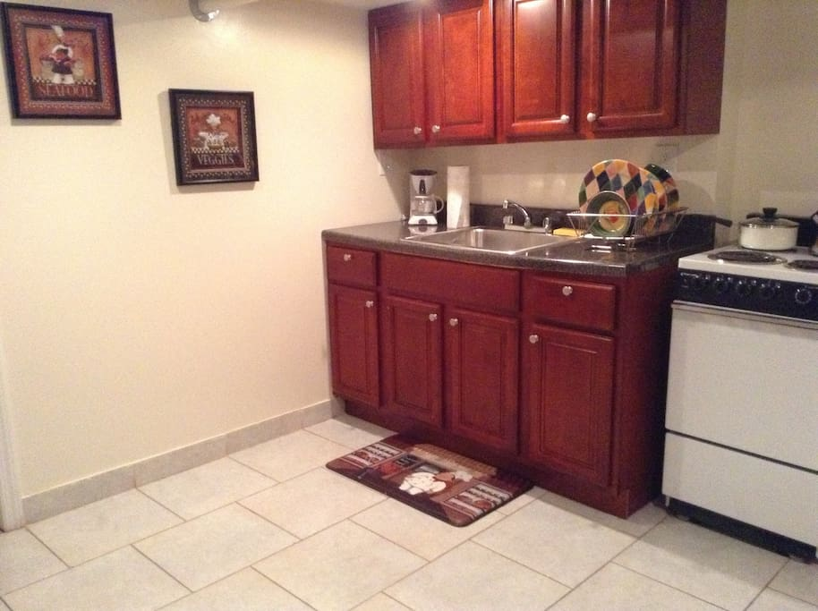 Coffee maker, dishes, pots & pans, and hot water kettle