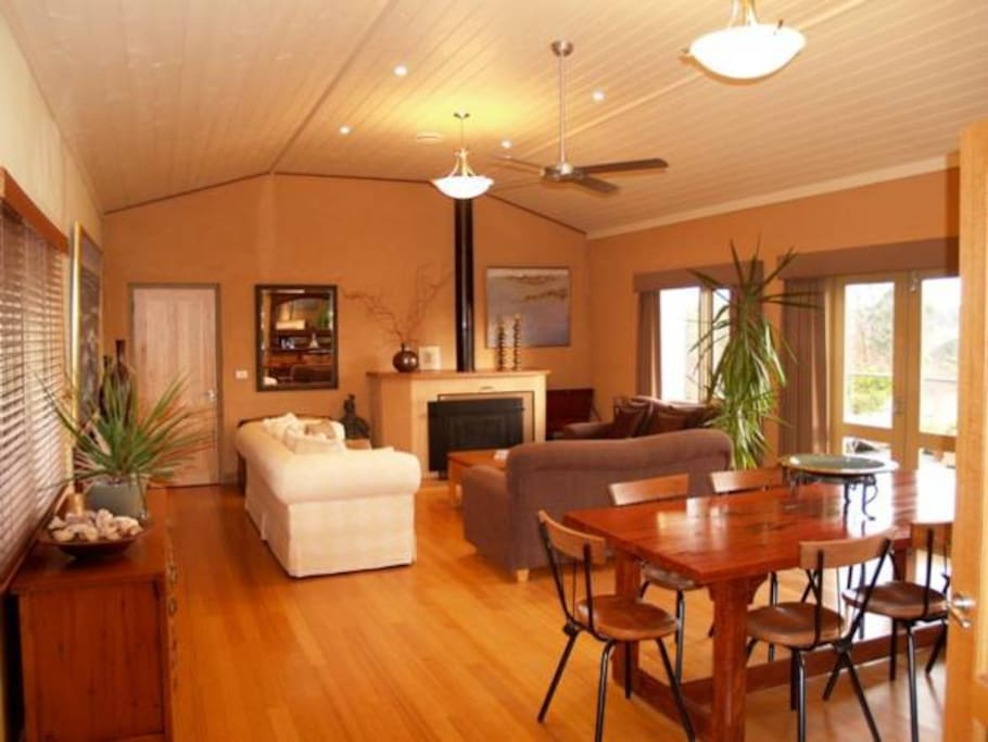 Open plan dining and lounge room with fireplace