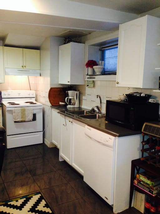 full kitchen available for your use, No Frills and 24 hr grocery stores are nearby