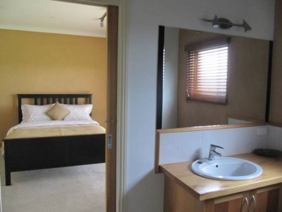 Private bathroom adjacent to bedroom