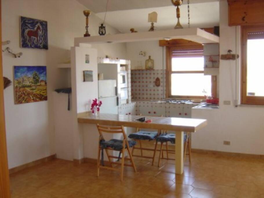 soggiorno angolo cucina