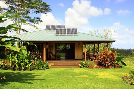 Puna district's natural beauty is the setting for our home.  Washed by trade winds you'll dine on the lanai & lounge on the sun/star deck in peace and freedom from bugs.   Morning seaview is a 3 acre wide sunrise.  Zillions of stars at night!