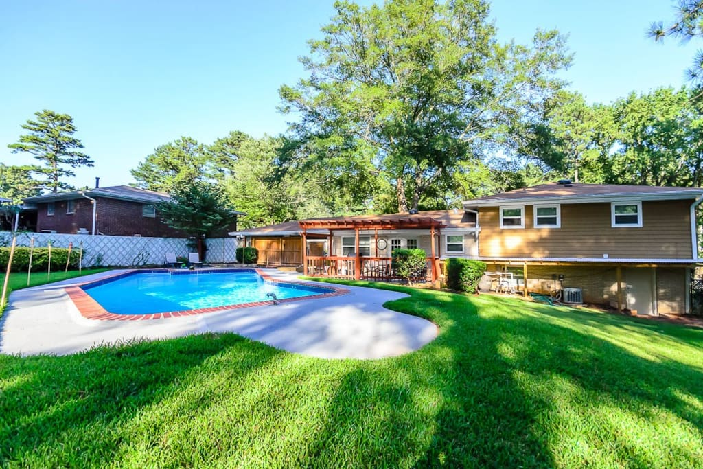 completely fenced in backyard with a private pool and well maintained yard