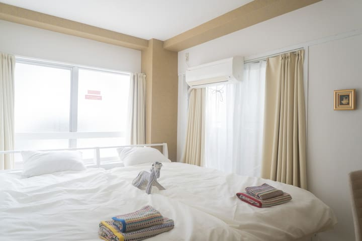 two single beds, hot and cold air conditioner in bedroom 1