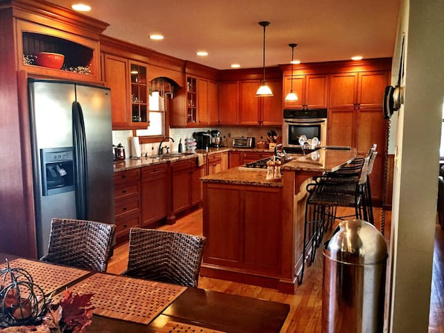 Cherry kitchen with granite counter tops.