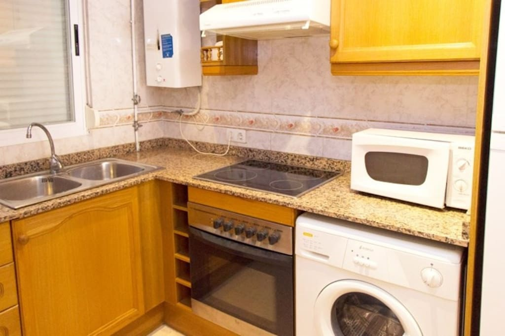 The fully functional kitchen features appliances, utensils, crockery, cutlery and a washer for added convenience