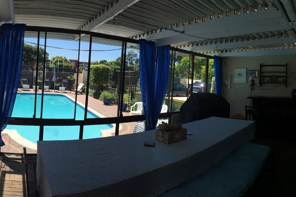Sunroom area with view onto pool